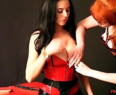 Mature redhead fucked by her busty girlfriends strap on
