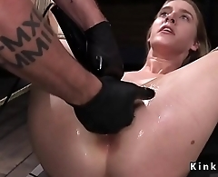 Hogtied blonde tormented in dungeon