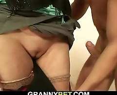 Granny prostitute sucks and rides his cock