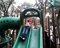 K3mbomb going down the slide with tits bouncing at public park