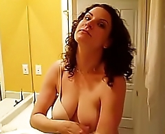 Hot Hooker stripping off shirt and bra to show off her slut tits