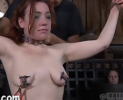 Fastened up hotty receives tongue and facial torture