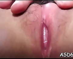 Lusty asian sex doll gives a cock ride and a consummate handjob