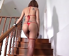 Thai babe undresses and spreads on the stairs
