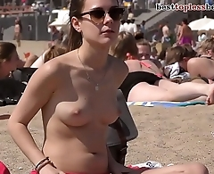Wonderful brunette babe Topless on the Beach
